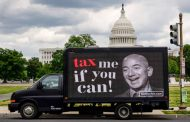 Millionaires who favor raising taxes on the rich launch protests in front of Amazon CEO Jeff Bezos' home on Tax Day